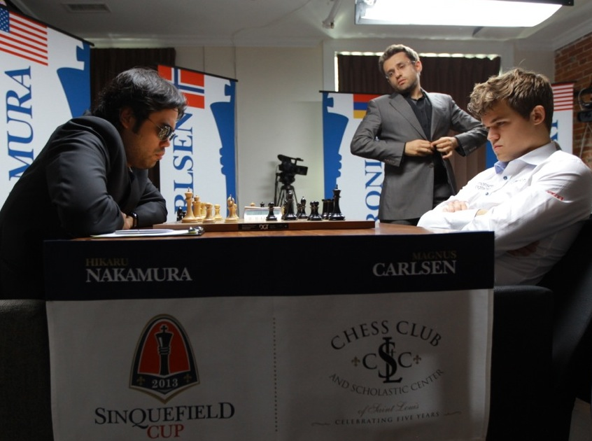 Hikaru Nakamura and Magnus Carlsen at the Sinquefield Cup in Saint Louis. Levon Aronian in background, observes the game. Photo Couretesy Saint Louis Chess Club.